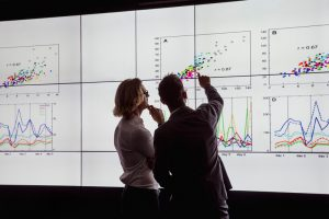 Quality Decisions - busines speople analysing graphs