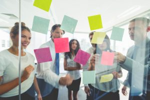 Quality Decisions - business people with post it notes